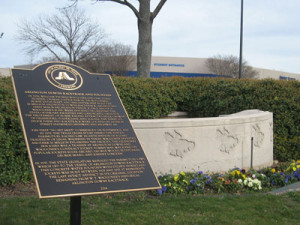 The historical marker honoring Arlington Downs