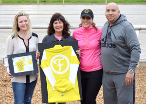 Pictured from left to right is Morgan Fontenot, Dawn Fontenot, Jen, Plaskett's girlfriend, and Rick Plaskett. Plaskett presented Fontenot with a set of yellow and white silks in honor of her father, Trainer Larry Fontenot Sr., who passed away in late 2015. (Photo by Linscott Photography)
