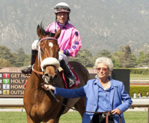 Colorado-bred Get Happy Mister enters the Santa Anita winner's circle with owner Annette Bishop. (Photo by Benoit Photo)