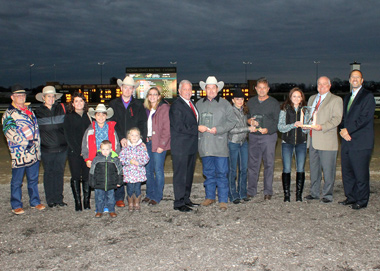 The Patrick Family was awarded three year-end titles Saturday, Oct. 31 at Indiana Grand. From right to left is:  Jon Schuster, vice president and general manager of racing, Kevin Greely, director of racing, Cheyanna Patrick, Juan Saez Leading Apprentice Jockey award winner, Steve Cahill, clerk of scales, Cindy Patrick, 2015 Leading Owner, Gary Patrick, 2015 Leading Trainer, , Brian Elmore, vice president of racing for Centaur Gaming, Jenea Patrick, Johnny Patrick, Colton Patrick, Asilynn Patrick and Dylan Happenny (front row), Amy Happenny, Sandy Ridley and Charlie Ridley. (Photo by Linscott Photography)