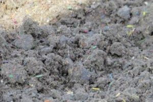 Detailed closeup of synthetic racetrack material for horse racing